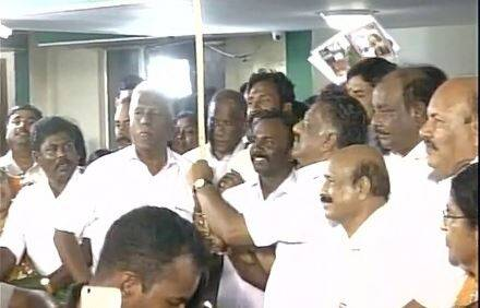 Supporters including transgenders felicitate O Panneerselvam at his residence after SC's DA case verdict that convicted Sasikala.