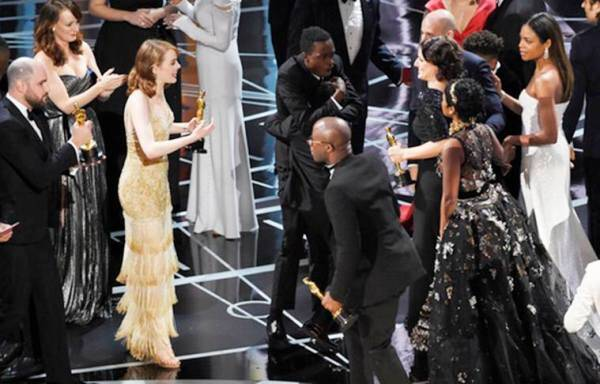 """Jordan Horowitz, far left, producer of """"La La Land,"""" and cast member Emma Stone greet """"Moonlight"""" cast members and filmmakers onstage after """"Moonlight"""" was announced as the true winner of best picture at the Oscars on Sunday, Feb. 26, 2017, at the Dolby Theatre in Los Angeles. It was originally announced mistakenly that """"La La Land"""" was the winner. (Photo by Chris Pizzello/Invision/AP)"""