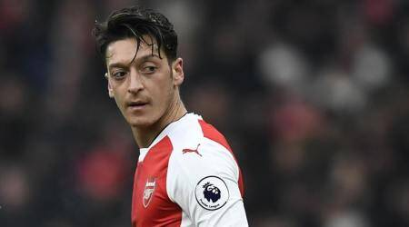 Mesut Ozil advices former Gunners to stop talking and startsupporting
