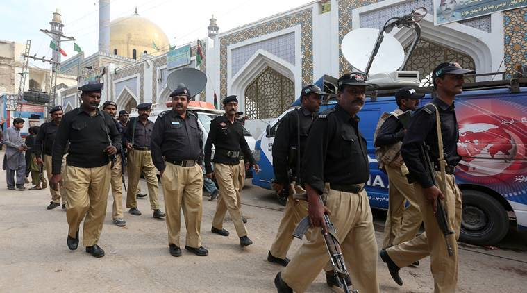 Policemen gather outside the tomb of Sufi saint Syed Usman Marwandi, also known as the Lal Shahbaz Qalandar shrine, after Thursday's suicide blast in Sehwan Sharif, Pakistan's southern Sindh province, February 17, 2017. REUTERS/Akhtar Soomro
