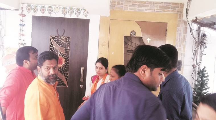 Shiv Sena candidates awaiting voters to open doors in Akurdi on Sunday. Manoj More