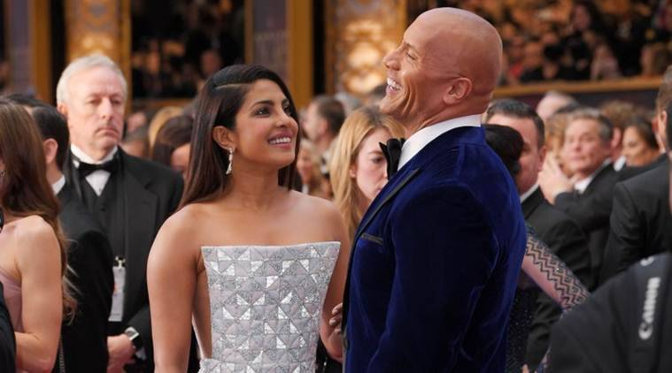 Oscars 2017: From Priyanka Chopra's red carpet look to her candit moment with Baywatch co-star Dwayne Johnson, find out all.
