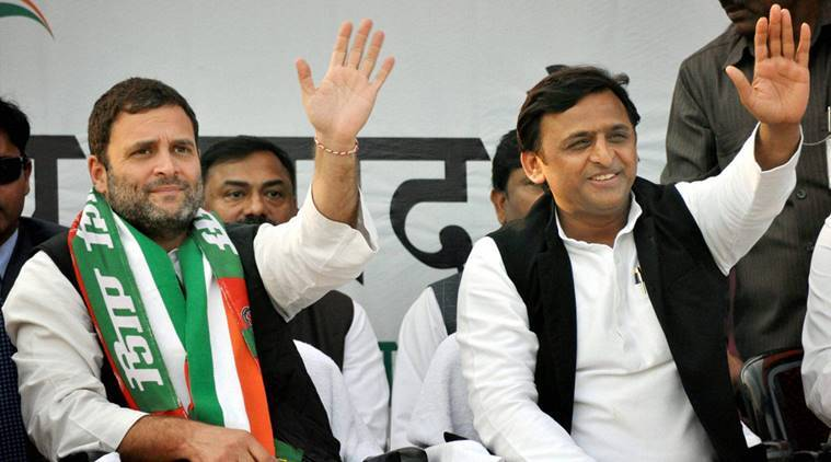 Kanpur: Congress Vice President Rahul Gandhi and UP Chief Minister Akhilesh Yadav wave to the crowd at a public rally in Kanpur on Sunday. PTI Photo(PTI2_5_2017_000214B)