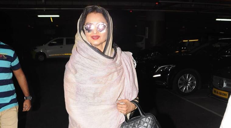 Rekha was seen pairing a beige linen sari with blue sport shoes and a linen stole covering her head. (Source: Varinder Chawla)