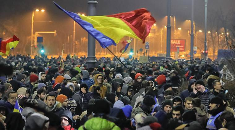 romania, corruption law, romania protests, romania corruption law, romania emergency, bucharest protest, bucharest protestors, world news, indian express news