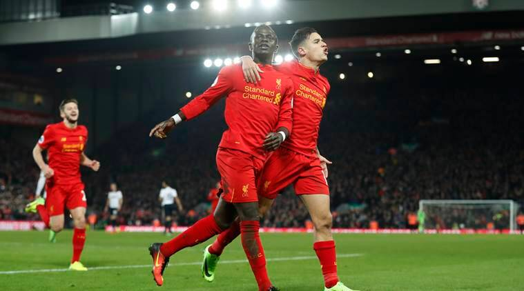 """Britain Soccer Football - Liverpool v Tottenham Hotspur - Premier League - Anfield - 11/2/17 Liverpool's Sadio Mane celebrates scoring their second goal with Philippe Coutinho Action Images via Reuters / Carl Recine Livepic EDITORIAL USE ONLY. No use with unauthorized audio, video, data, fixture lists, club/league logos or """"live"""" services. Online in-match use limited to 45 images, no video emulation. No use in betting, games or single club/league/player publications. Please contact your account representative for further details."""
