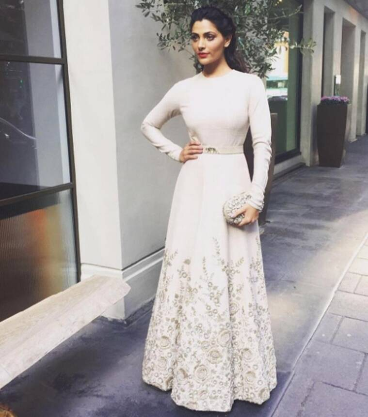 At Mirziya's promotion in London, Saiyami Kher was seen in a beautiful floor length ivory gown by Sabyasachi which was beautifully embellished with zardozi embroidery at the bottom. A pop of red lip shade rounded out the look, She looked lovely.