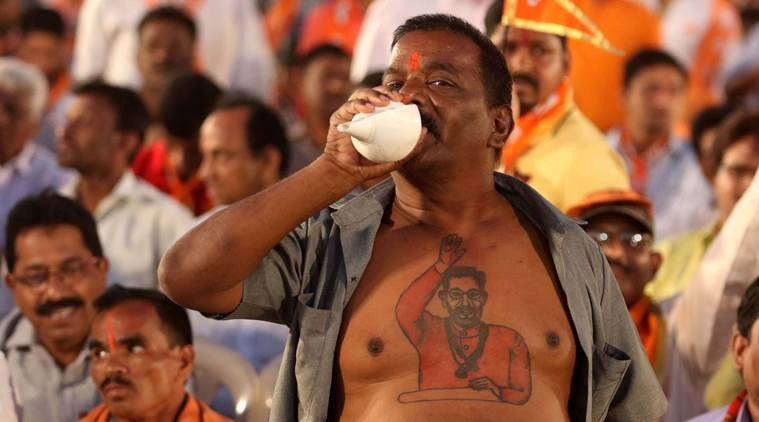 Shiv Sena supporter blow a conch during the Uddhav Thackeray's rally for the Mumbai Municipal corporation election, at Bandra Kurla complex in Mumbai on Saturday. Election for the corporation will be held on 21st February. Express photo by Prashant Nadkar, 18th February 2017, Mumbai.