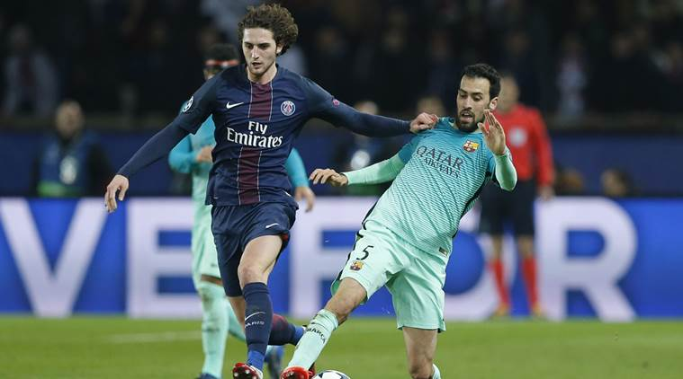 Barcelona's Sergio Busquets in action with Paris Saint-Germain's Adrien Rabiot