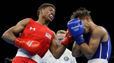 Bid for gold behind them, Olympic boxers go for pro riches