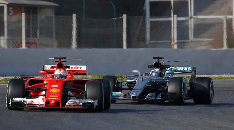 Mercedes driver Valtteri Bottas of Finland, right, follows Ferrari driver Sebastian Vettel of Germany through a curve during a Formula One pre-season testing session at the Catalunya racetrack in Montmelo, outside Barcelona, Spain, Monday, Feb. 27, 2017. (AP Photo/Francisco Seco)