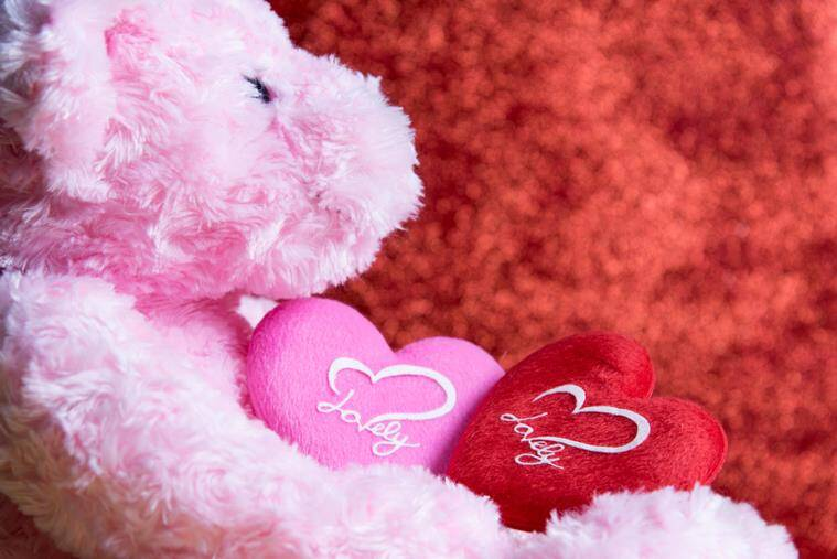 Teddy Bear With Heart On Red Background,concept Valentine
