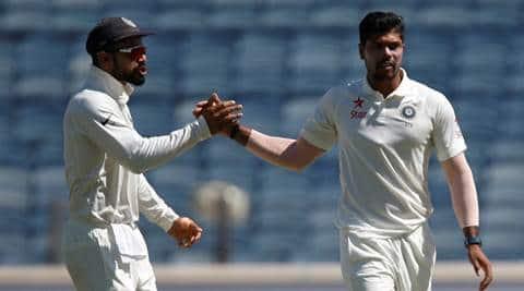 Cricket - India v Australia - First Test cricket match - Maharashtra Cricket Association Stadium, Pune, India - 23/02/17. India's Umesh Yadav celebrates with team mate Virat Kohli the wicket of Australia's David Warner. REUTERS/Danish Siddiqui