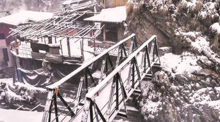 the Yamunotri shrine, at a height of 10,800 ft. One of the sadhus here says he hasn't crossed the bridge to climb down in several decades. (Source: Express photo by Ashutosh Bhardwaj)