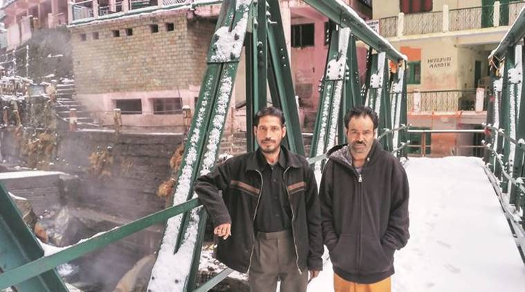 Virendra Rawat (left) and Kesar Singh Rawat, a disciple and sadhu at Yamunotri shrine. Unless snow stops them, they say they will trek down 6 km to vote. (Source: Express photo by Ashutosh Bhardwaj)