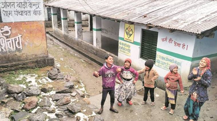 Outside a school that will serve as a poll booth, children enjoying the rain that has melted the snow. This booth, in Janaki Chatti village, the base station of the Yamunotri shrine, will be the last in Uttarakhand before the China border. (Source: Express photo by Ashutosh Bhardwaj)