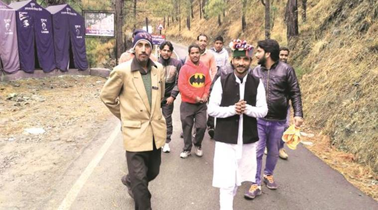Jay Prakash Ghaluan, a Sarv Vikas Party candidate from Yamunotri, campaigning at a height of 6,500 ft. Being young, the 33-yr-old says, he can reach these areas. (Source: Express photo by Ashutosh Bhardwaj)
