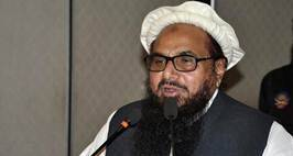 Hafiz Saeed, Chief of Pakistan's religious group Jamaat-ud-Dawa addresses a seminar in Lahore, Pakistan, Monday, Jan. 30, 2017. ÔªøPakistan has placed the leader of a charity linked to a militant group under house arrest. Hafiz Saeed, whose Jamaat-ud-Dawa is a front for Lashkar-e-Taiba, the group behind the 2008 Mumbai attacks, was placed under house arrest along with four aides.(AP Photo/K.M. Chaudary)