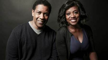 """FILE - In this Saturday, Dec. 17, 2016 file photo, Denzel Washington, left, and Viola Davis pose for a portrait at the Four Seasons, in Los Angeles. With """"Fences,"""" ''Hidden Figures,"""" ''Loving"""" and """"Moonlight"""" in the Oscar mix, #Oscarssowhite may be a thing of the past. Is this a blip or signs of progress? And if there aren't big wins, is it still a win for diversity? (Photo by Rich Fury/Invision/AP)"""