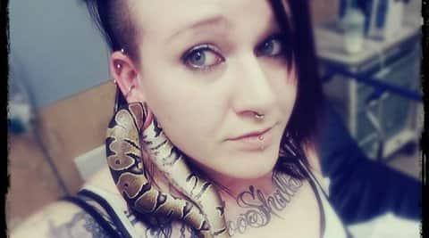 woman ball python pet earlobe, ashley glawe, oregon woman pet snake earlobe, bizarre news, weird news, snake news, bizarre animals, indian express, indian express news