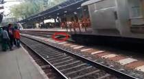 WATCH: Woman comes under running train; here's what happens next