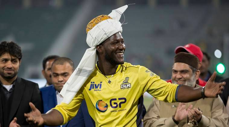 Former West Indies captain Darren Sammy gestures wearing a traditional turban at Gaddafi stadium in Lahore, Pakistan, Sunday, March 5, 2017. Sammy led Peshawar Zalmi to the Pakistan Super League Twenty20 title with a 58-run victory against Quetta Gladiators in a trouble-free final on Sunday. (AP Photo/K.M. Chaudary)