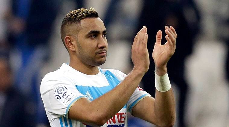 Marseille's Dimitri Payet applauds supporters after the League One soccer match between Marseille and Paris Saint-Germain, at the Velodrome Stadium, in Marseille, southern France, Sunday, Feb. 26, 2017. (AP Photo/Claude Paris)