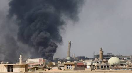 Islamic State shells recaptured areas in westMosul