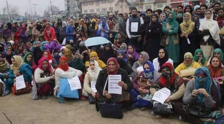 Contractual employees in J&K stage protest demanding regularisation, police foilattempts