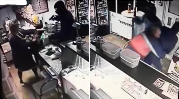 funny videos, viral videos, russian fights burglars in a abr, russians drinking, man fights robbers in a bar, man fights robbers, indian express, indian express news
