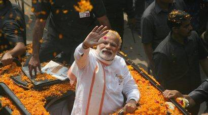 PM Modi greets crowd at road show in Varanasi, conducts puja at Kashi Vishwanath temple
