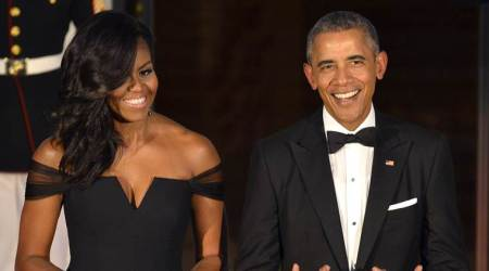 Michelle Obama reveals how she was scrutinised for every dress while Barack Obama wore the same tux for 8 years