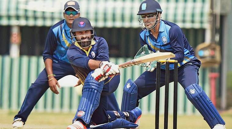 Nadia: J-K Captain Parvez Rasool playing a shot as Jharkhand Captain M S Dhoni looks on during the Vijay Hazare Trophy at Nadia in West Bengal on Monday. PTI Photo by Ashok Bhaumik(PTI3_6_2017_000089B)