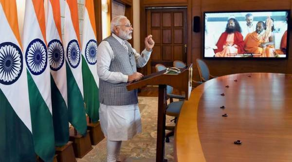 New Delhi: Prime Minister Narendra Modi addressing the inaugural function of Annual International Yoga Festival at Rishikesh, through video conferencing, in New Delhi on Thursday. PTI Photo/PIB(PTI3_2_2017_000097A)