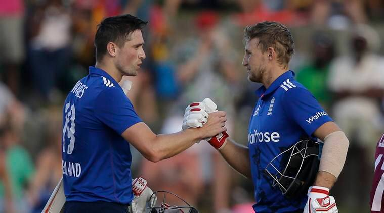 England's batsmen Chris Woakes, left, and Joe Root celebrates defeating West Indies by four wickets during their second one day international cricket match at the Sir Vivian Richards Stadium in North Sound, Antigua, Sunday, March 5, 2017. (AP Photo/Ricardo Mazalan)