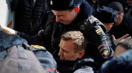 Dozens detained in anti-corruption protests across Russia