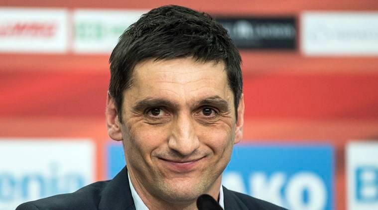Leverkusen's new interim coach, Tayfun Korkut attends a news conference in Leverkusen, Germany, Monday March 6, 2017. After the club sacked Roger Schmidt on Sunday, Korkut was presented as interim coach on Monday. (Federico Gambarini/dpa via AP)