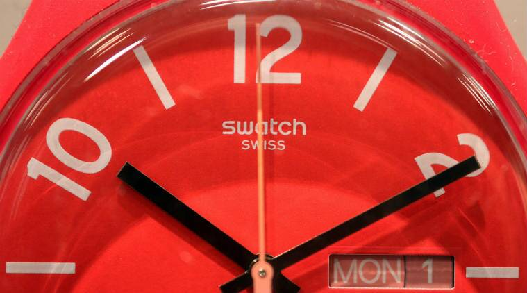 Swatch Group AG, alternative to smartwatch OS, iOS smartwatch, Android smartwatch, Swiss made system, Tissot brand, connect IoT devices, four century old watch industry, Android 2.0 Technology, wearable devices, battery drainage, Swatch products, luxury industry, Swiss Center for Electronics and Microtechnology, Tissot smart Touch smartwatch, solar powered smartwatch, Android, iOS, Technology, Technology news