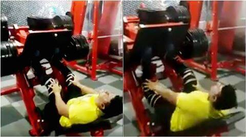 crazy video, gym video, man breaks leg in gym, man breaks leg gyming, man breaks leg lifting weights, indian express, indian express news