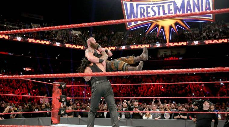 wwe raw results undertaker goes down to roman reigns only