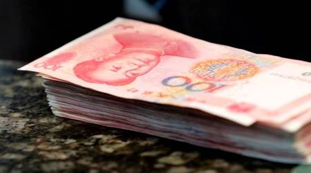 China's yuan firms against US dollar relative to Friday's late close