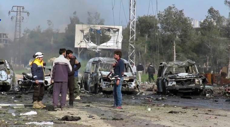 syria, syria bomb attack, bomb attack on syria evacuees, suicide car bombing on syria evacuees, syria news, children dead in syria attack, syria bombing attack-children dead, world news, syria news, indian express