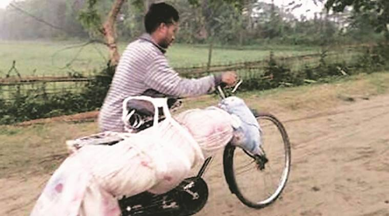 assam, assam man body on cycle, assam man carries body on cycle, assam news, assam cm, Sarbananda Sonowal, india news, latest news, indian express news