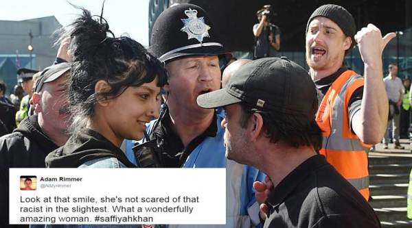 Westminster attack, Saffiyah Khan, English Defence League, Birmingham far right group protest, Saffiyah Khan stare photo, bristish woman stare and smile at racist proteors, britain news, uk news, latest news, social media news, viral photo, indian express