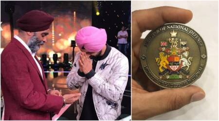 Diljit Dosanjh receives coin of honour from Canada's Minister of National Defence. See pics