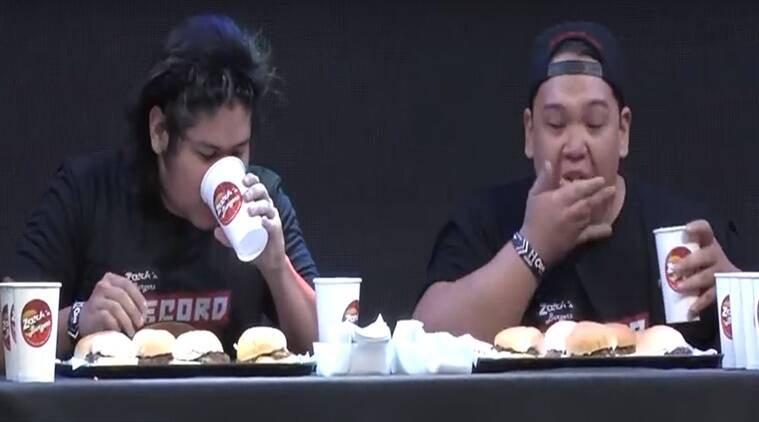 viral videos, guinness records videos, funny videos, eating videos, guinness world records, guy eating hamburgers, guy from Philippines eats most number of hamburgers, burger competition, indian express, indian express news