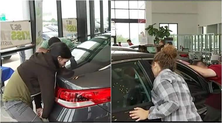 kissing contest, kiss to win a car, kissing car contest, longest kissing contest, kiss to win kia car, austin kia kissing contest, bizarre news, odd news, latest news, world news, auto news, viral news