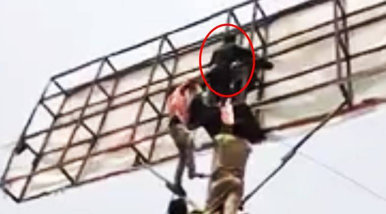 man attempts suicide to convince ex, man convinces ex by climbing hoarding, man climbs hoarding to threaten ex to get back with him, man climbs hoarding to convince fiancee to get back, indian expres, indian express news, trending