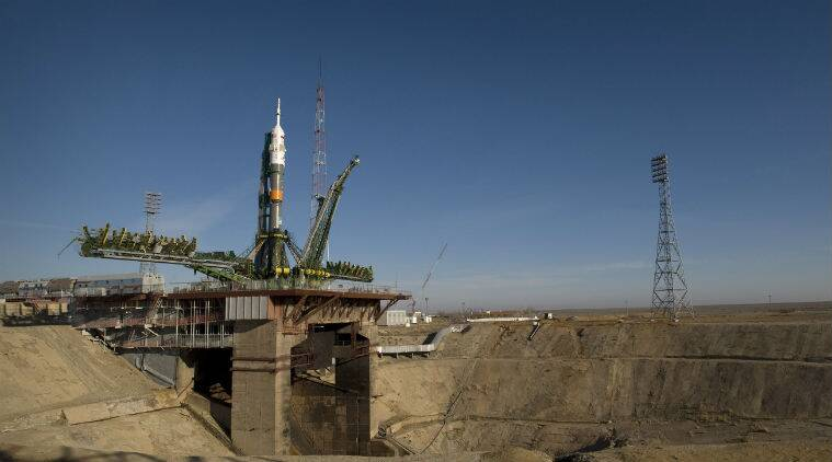 Soyuz space capsule carrying American, Russian blasts off for International Space Station