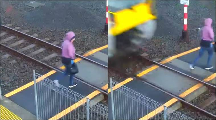 woman in new zealand misses train hit, woman crossing railway track. new zealand woman hit by a train, woman saved from being hit by train, viral videos, scary videos, indian express, indian express news